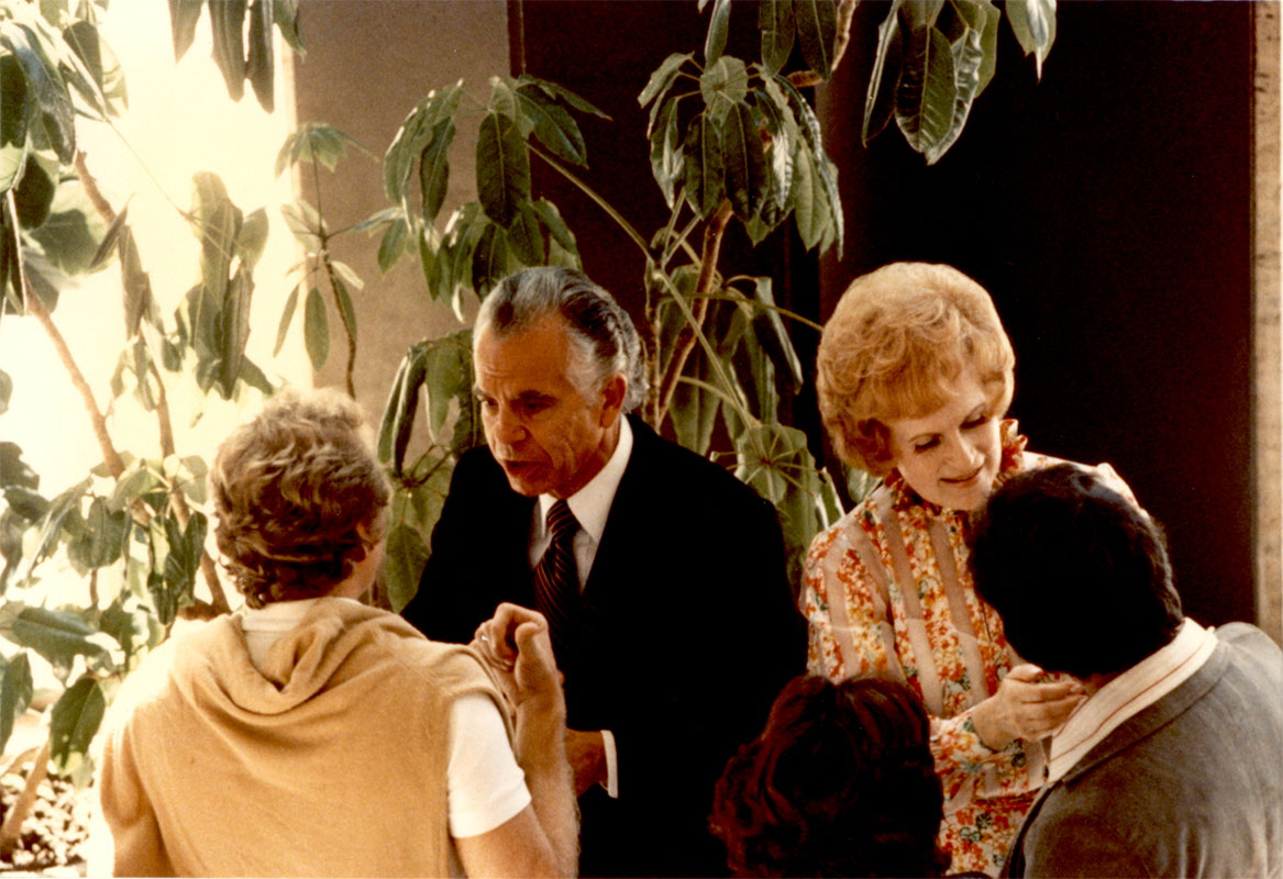 The couple is greeting congregants at Avery Fisher Hall, Lincoln Center, New York City.  Butterworth began his New York City ministry in 1961.  He lectured every Sunday at Carnegie Hall, then Town Hall, then Avery Fisher Hall at Lincoln Center, where the weekly attendance grew to several thousand.